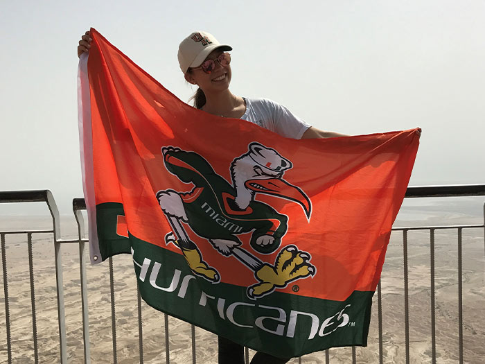 Casey Dresbach holding Miami Hurricane Flag