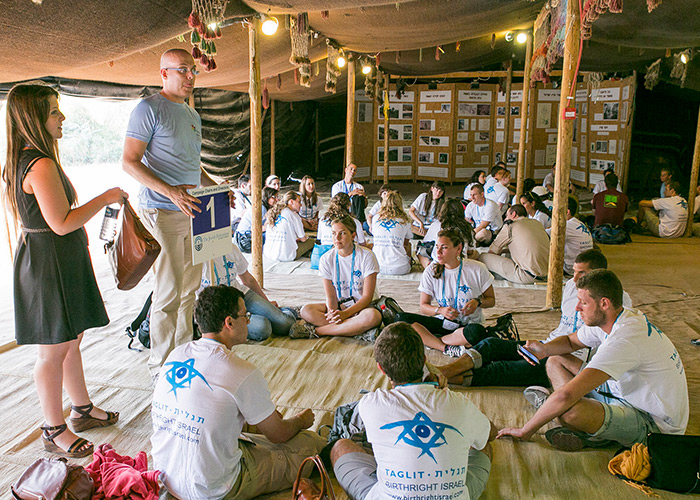 Birthright Israel participants in a tent in the Negev