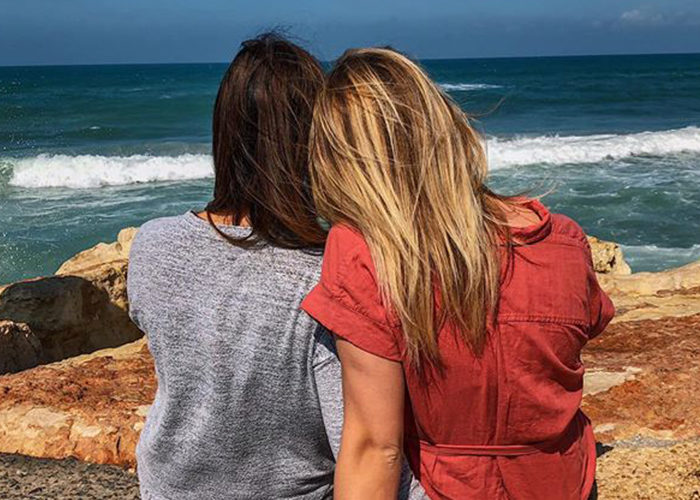 Emily with her sister at the beach in Israel