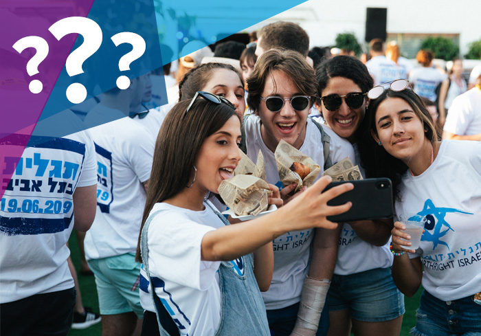 Birthright Israel participants taking a selfie while enjoying falafel in Tel Aviv