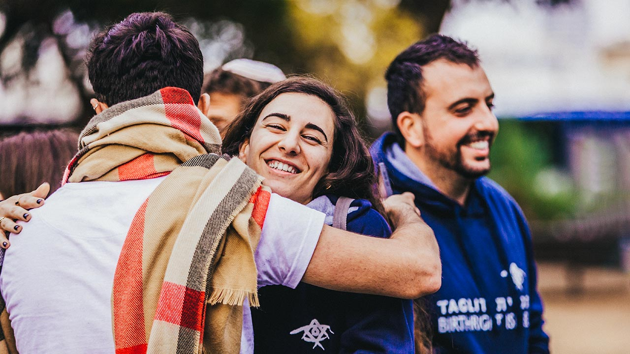 Birthright Israel participants hugging on their 2020 winter Birthright Israel trip