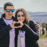 Two winter 2020 Birthright Israel alumni forming a heart with their hands