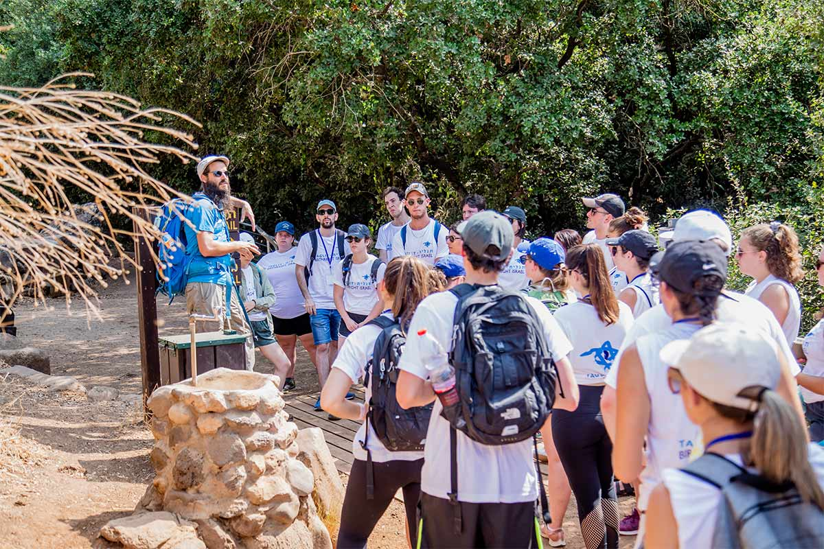 A Birthright Israel group listening to their Tour Educator