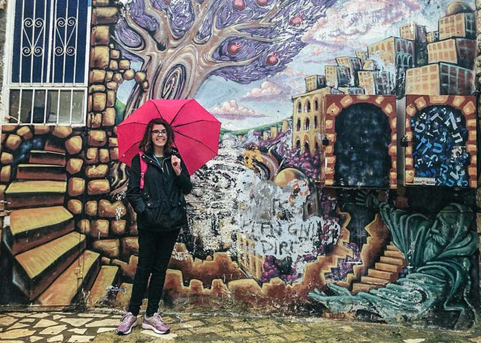 Haley Albin in front of a mural in Tzfat on her Birthright Israel trip in the winter of 2020