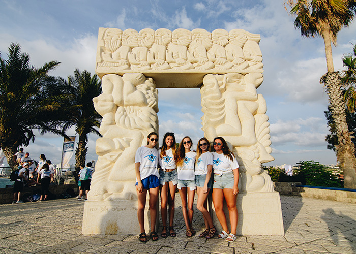 Birthright Israel participants standing in front of a statue in Jaffa, Israel.