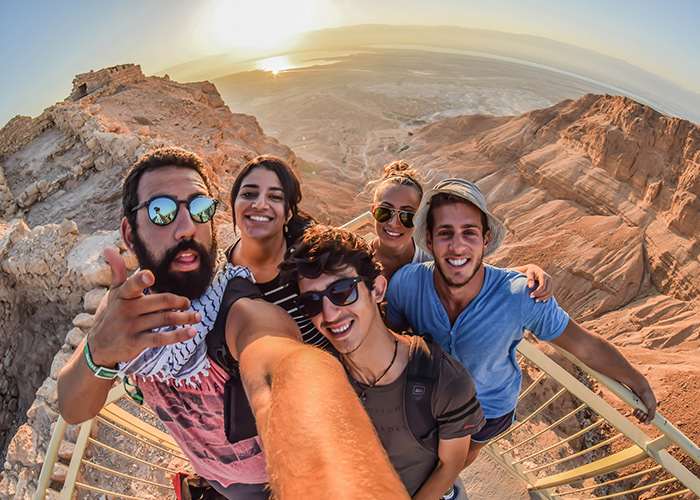 Participants taking a selfie at Masada
