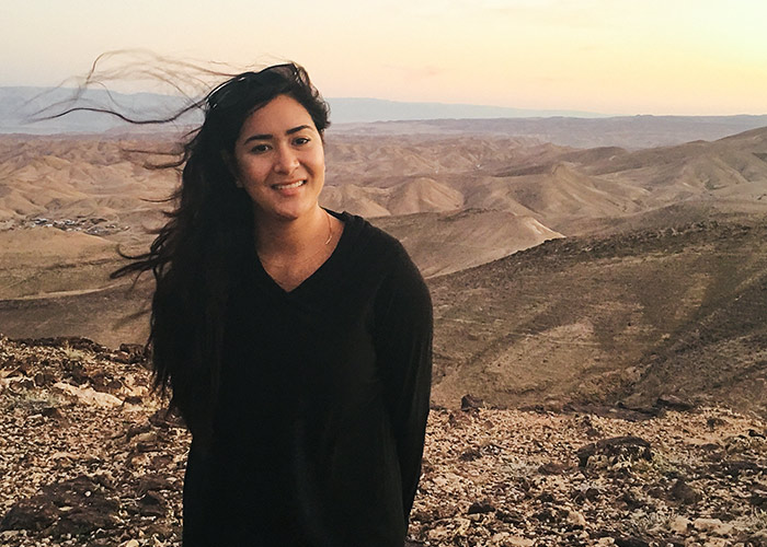 Alix Ablaza in the Negev on a windy day at sunrise on her 2015 Birthright Israel trip