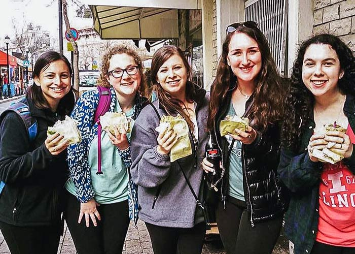 Jordyn Landau eating falafel with her 2017 Birthright Israel group