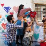 Birthright Israel participants hanging a heart sculpture