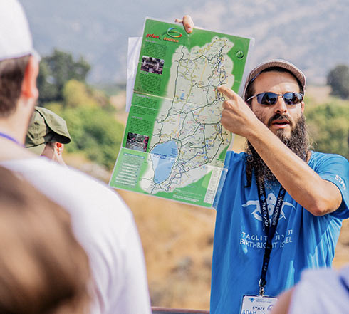 A Birthright Israel tour educator describing a map of Galilee in northern Israel