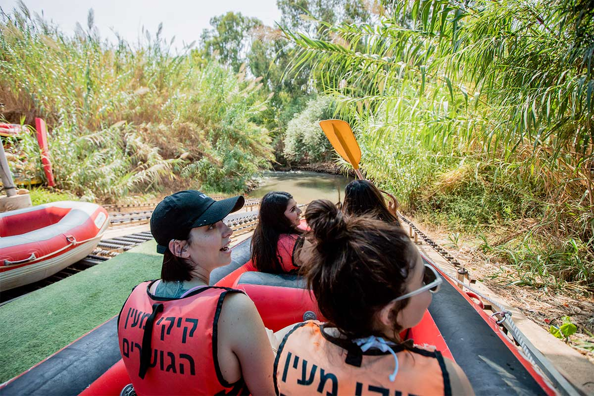 Birthright Israel participants kayaking in the Jordan river.
