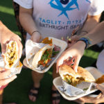 Birthright Israel participants eating falafel