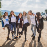 Girls on Birthright Israel kicking their legs in the air