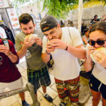 Birthright Israel participants eating falafel