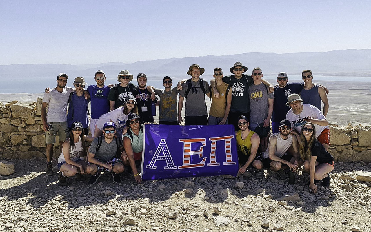 Cooper Myers with a group of his AEPi fraternity brothers on top of Masada on Birthright Israel in 2019