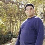 Matthew Labkovski standing under some trees in Israel