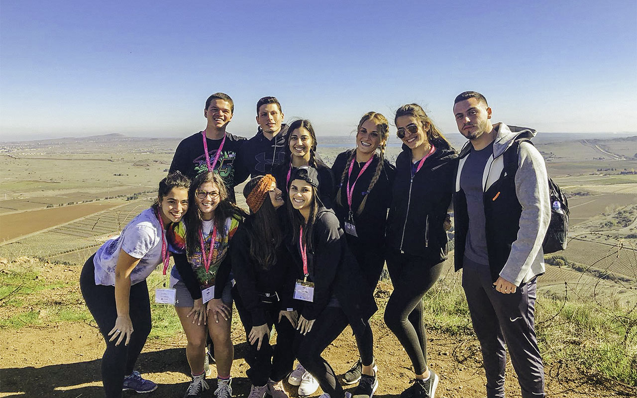 2019 Birthright Israel Mifgash Alumnus Snir Lasri with members of his group in the Golan Heights