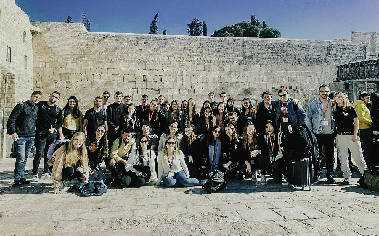 Snir Lasri with his Birthright Israel group at the Kotel in 2019