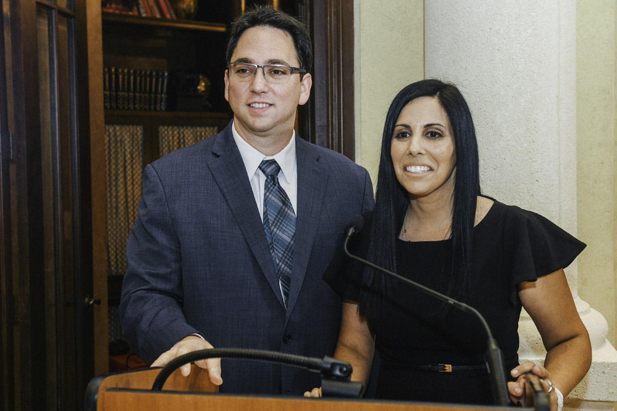 Holly & Chad Sokoloff standing at the podium at a Birthright Israel Foundation event