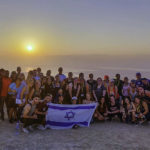 Max Gutnick with her Birthright Israel group on top of Masada at sunrise