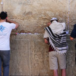 Birthright Israel participants praying at the Western Wall