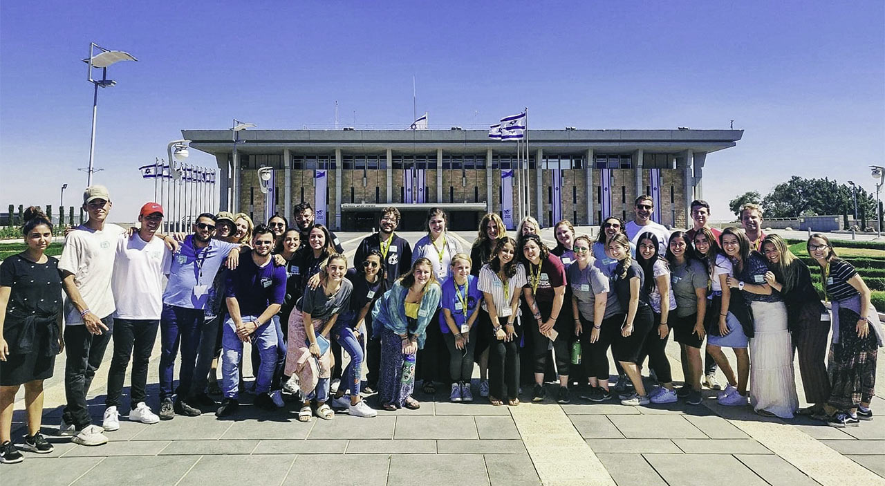 Max Gutnick with her Birthright Israel group in front of the Knesset in 2019