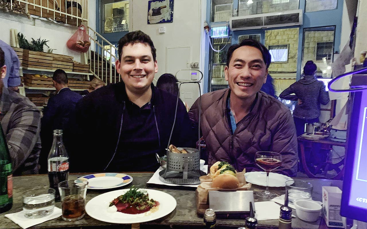 Alex Lin-Goldsmith at dinner with his husband Danny on their Birthright Israel trip