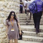 NYC Birthright Israel alumna Carly Alterman on stone stairs in Jerusalem