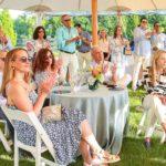 Guests applaud Birthright Israel alumni speakers in the Hamptons in 2021